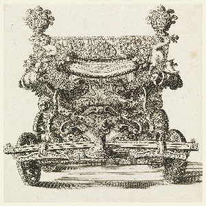 Front view of carriage decorated with carved putti, vegetation, and scrolls.