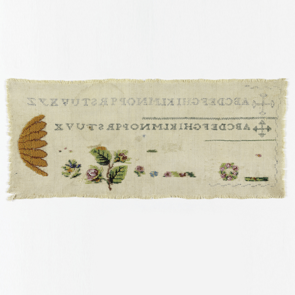 Two alphabets and borders of cross stitch on one side. Other side has flowers in beadwork.