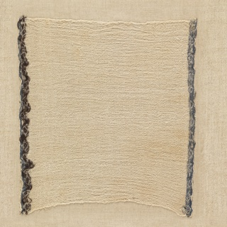 Fragment of a loosely-woven plain crepe cloth with borders in brown and blue. Piece was found near Ancayama, Chancay Valley.