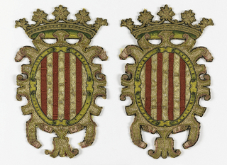 Oval shield with red and gold vertical stripes surrounded by gold arabesqued mantle, topped with crown with rosettes across top. Details of shaded pink and green satin stitch; black outlines.