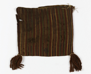 Flat bag woven in stripes of red, green, yellow and brown. Hand sewn at sides to form bag. Red tassels at corners.  warp selvage for bag opening, reinforced by overcasting