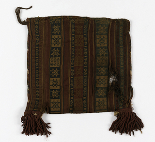 Flat bag, woven in alternate perpendicular stripes of red with geometric pattern, green and tan with geometric pattern; narrow green with S-curve in tan. Sides hand stitched to form bag. Tassels at corners. warp selvage for opening of bag