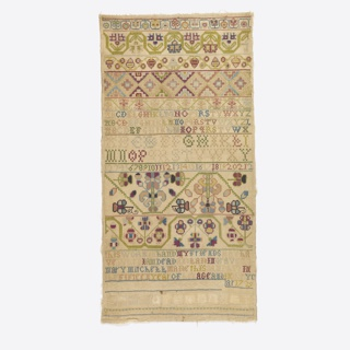 """Bands of pattern in polychrome.  In middle two alphabets and numbers.  At bottom verse, """"This work in hand my friends may have when I am dead and laid in grave Mary Mitchel made this sampler in the fifteenth year of my age in the year 1729."""""""