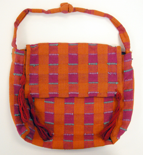Woven cloth bag with a front flap and strap. Fabric is a hand-woven cotton in which the warps are thinner and more tightly twisted than the loosely-twisted, slubby wefts. Wide stripes in each direction are interrupted occasionally with very narrow ones of 2 warps or wefts each. The vertical stripes are accented with insertions of discontinuous weft which is very thick and raised.