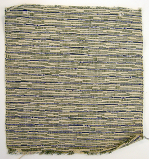 Sample of hand woven cotton in which the warps are much thinner and more tightly twisted than the loosely-twisted, slubby wefts. The wefts are grouped in combinations which vary across the width of the fabric, giving a meandering, rather than strictly grid-like, appearance. Olive and ivory warps; purple and ivory wefts.