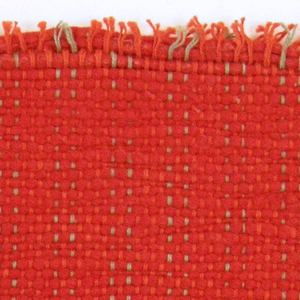 Sample of hand-woven cotton in which the warps are much thinner and more tightly twisted than the loosely-twisted, irregularly spun wefts, which vary in thickness across their length. Orange and light green warps; red-orange wefts.