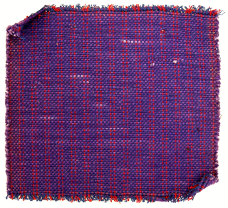 Sample of hand-woven cotton in which the warps are much thinner and more tightly twisted than the loosely-twisted, irregularly spun wefts, which vary in thickness across their length. Royal blue and red warps; mottled purple wefts.