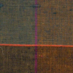 Sample of a hand woven cotton plaid with a slightly slubbed texture. Warp has wide bands of burnt orange and olive with narrow stripes of fuchsia; weft has wide bands of green and navy with narrow stripes of bright red.