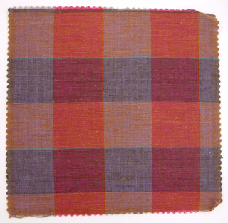 Sample of a hand woven cotton plaid with a slightly slubbed texture. Warp has wide bands of purple and bright pink with narrow stripes of orange; weft has wide bands of burnt orange and olive with narrow stripes of turquoise.