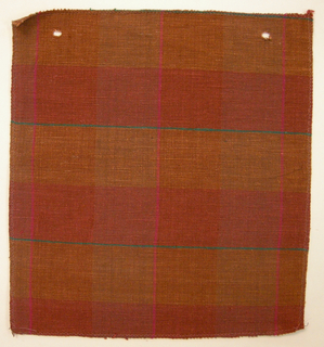 Sample of a hand woven cotton plaid with a slightly slubbed texture. Warp has wide bands of burnt orange and taupe with narrow stripes of hot pink; weft has wide bands of soft red and burnt orange with narrow stripes of emerald green.