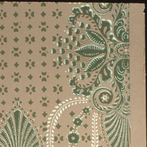 Large rosettes with palmettes extending vertically, connected with floral bands and leafy stems. Green and white on cocoa ground. Drop match, drop repeat.