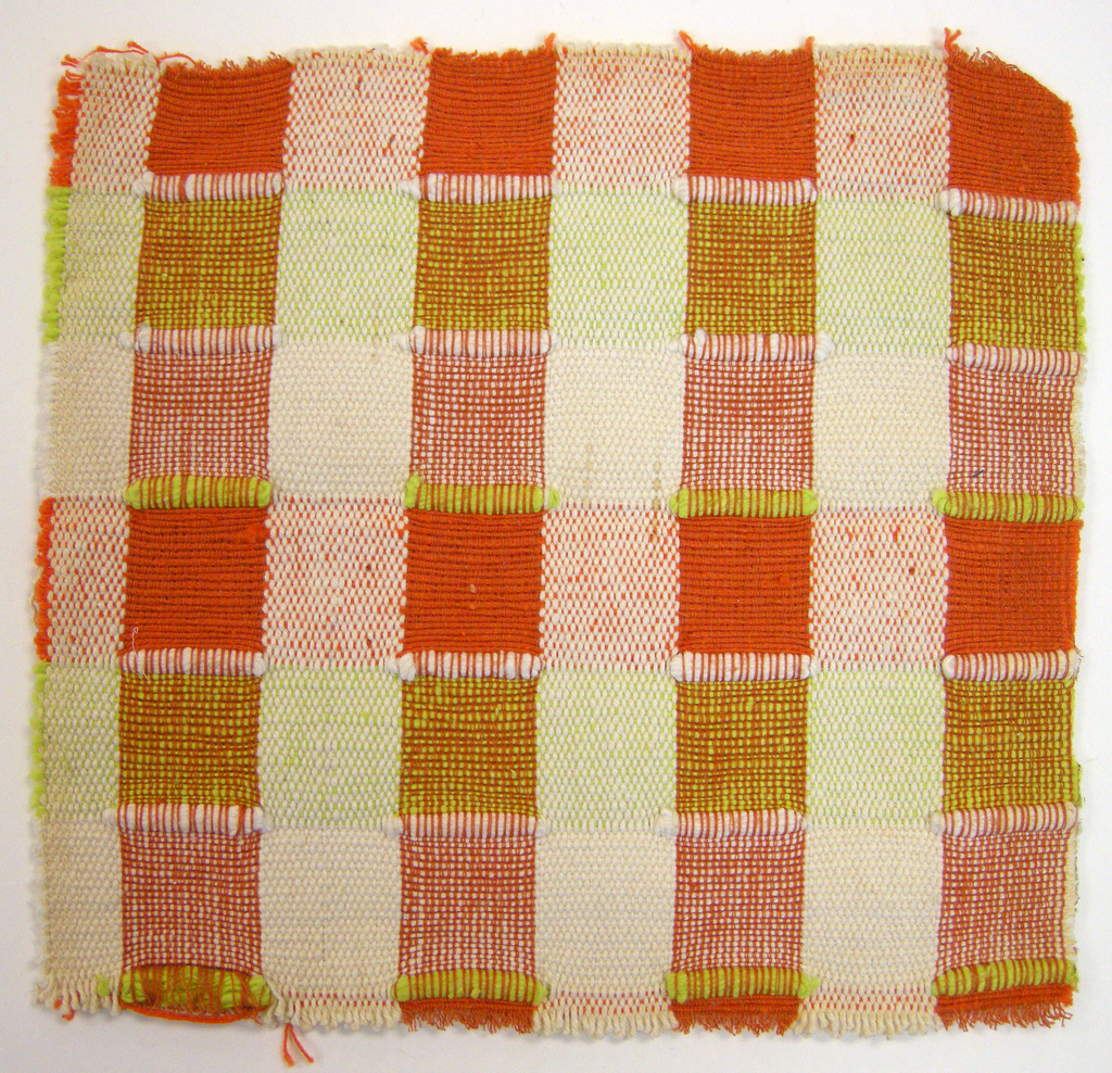 Sample of hand-woven cotton in which the warps are thinner and more tightly twisted than the loosely-twisted, slubby wefts. Wide stripes in each direction are interrupted occasionally with very narrow ones of 2 warps or wefts each. The vertical stripes are accented with insertions of discontinuous weft which is very thick and raised. Orange and ivory warps; orange, light green and ivory wefts; ivory and light green brocading yarns.