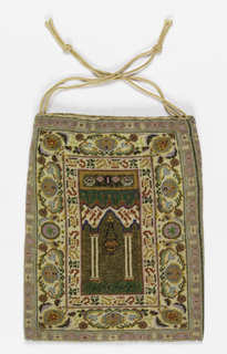 Beaded bag lined with beige silk damask with a drawstring top. The pattern is identical on both sides: a center panel with a prayer niche and lamp; geometric inner border, middle border with an abstracted floral design, and geometric outer border. In many colors, predominately beige, pink and blue.
