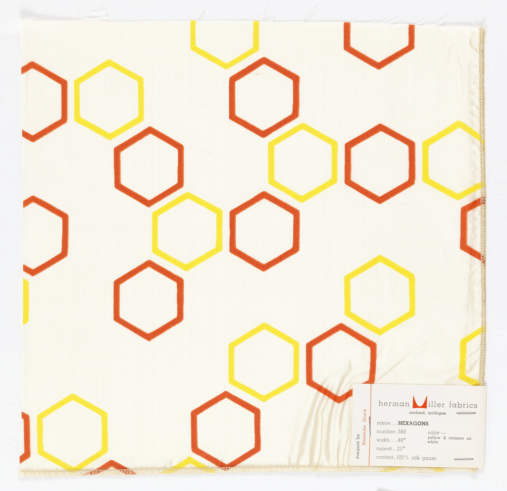 Red and yellow hexagons printed on off-white ground. Serged on 2 sides and cut on 2 sides.