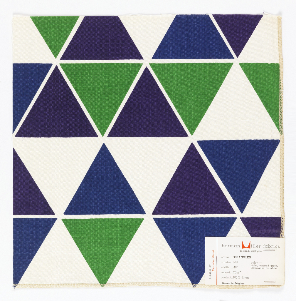 Rows of triangles printed in blue, green and purple on white. Serged on two sides, cut on two sides.