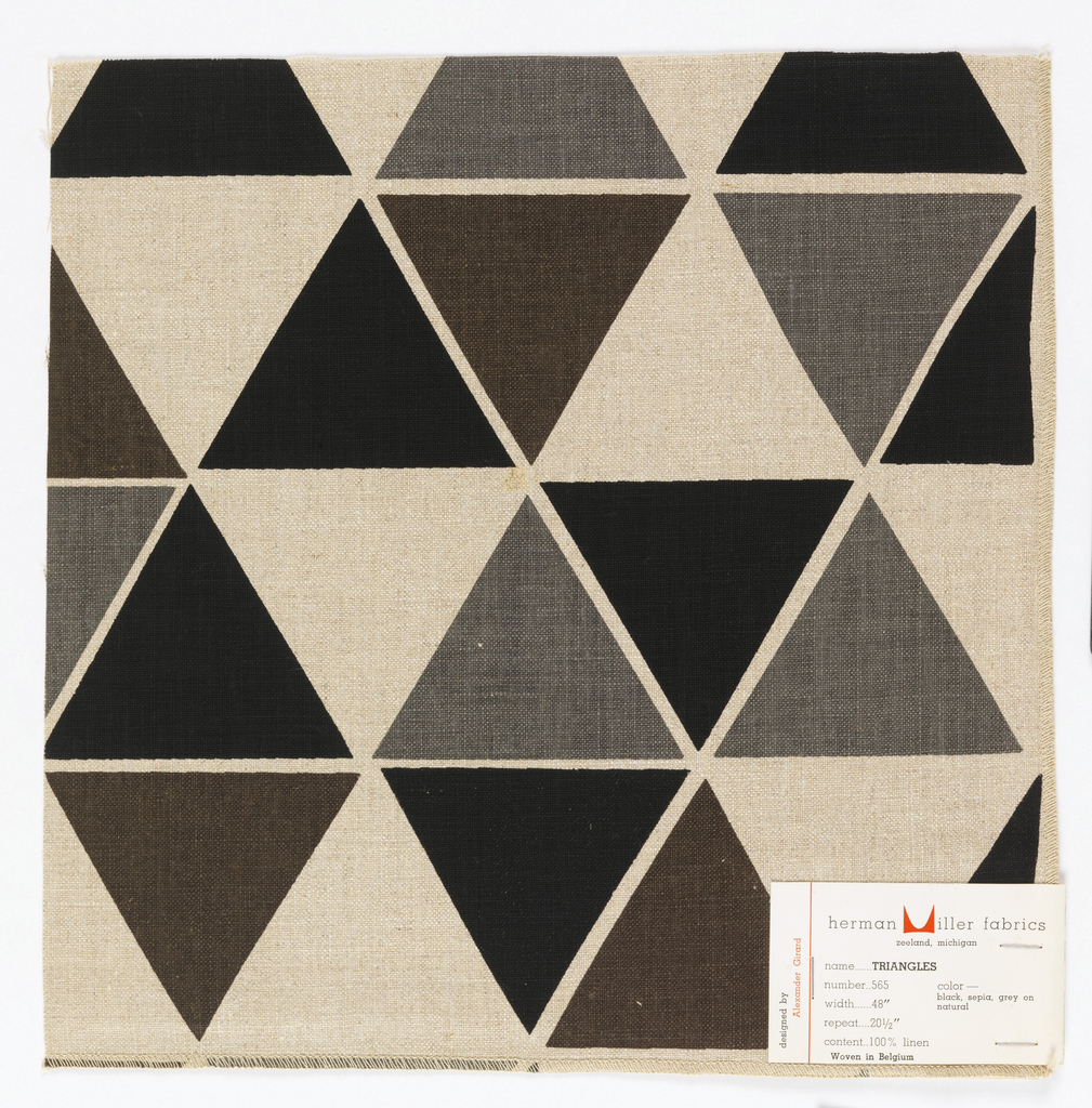 Rows of triangles printed in grey, black and brown on tan.  Serged on two sides, cut on two sides.