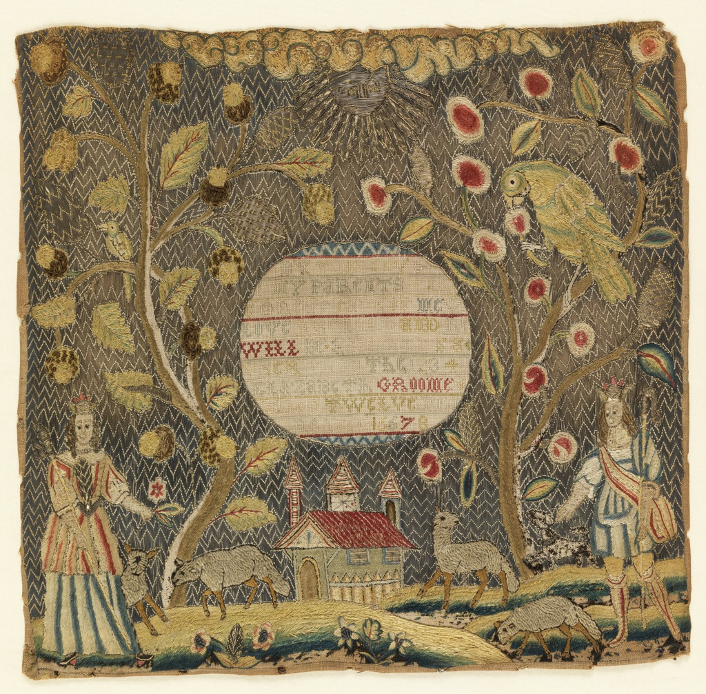 Scene of a crowned shepherd and shepherdess in a rural landscape with sheep and a dog, an oak tree to the left and an apple tree with a large parrot to the right, the sun at the top and a church at the bottom. Mica is used as the windows of the church; the background is of couched metallic yarns. In the center a reserved circle with the inscription: