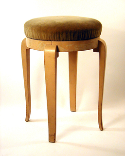 Round seat, covered with putty-colored mohair velvet, swiveling on ivory-painted round frame with four legs having convex curve where they are joined to frame, and a gentle taper and curve at base.