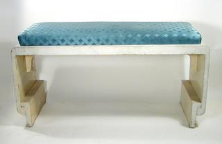 Rectangular wooden bench (a); slip seat cushion covered in blue lattice work fabric (b).