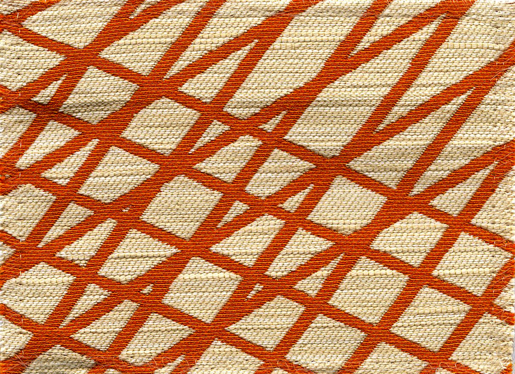 Length of woven fabric with diagonally crossing lines of orange on a white ground. Offered in twenty-five colorways.