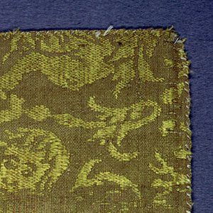 Design of animals, birds and putti in yellow and tan.