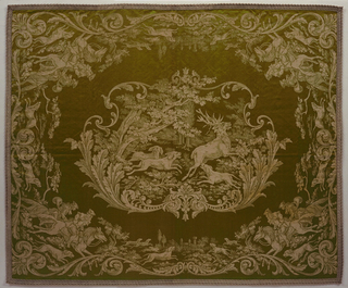 Green satin with design in white. In the central scene, a stag is pursued by hounds amid foliage; in the corners, mounted riders with hounds; foliage borders. Edged with narrow silver galloons.