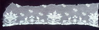 Fragment of needlework on net