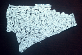 Fragment of continuous tape bobbin lace.