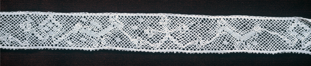 Fragment of Lille-style insertion lace in a pattern of rectangles.