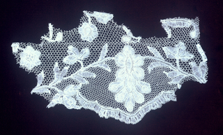 Fragment of Brussels type bobbin lace. Made with both needle and bobbin made ground. 18th c, Northern Europe