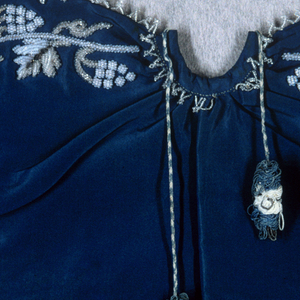 """Small cape for an ecclesiatic figure, the """"Bambino"""". Blue silk grosgrain with grapevine design embroidered in white and cream coloured glass beads and silver sequins along the edge. Lined with blue silk twill."""