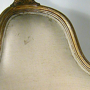 Louis XVI upholstered corner chair with the original gilding and webbing.