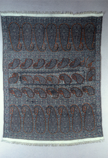 Cover which is a patchwork of pieces salvaged  from a larger shawl.