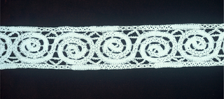 Band with tape like scroll design.