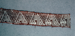 Funerary textile with a zigzag band of Kufic script in red and white.