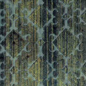 Scrolling forms and diamond shapes in green. Selvage at left.