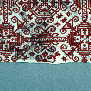 Strip of embroidered linen embroidered in red silk. Detached motives similar to Aegean Island ornament. Possibly worked in Egypt.