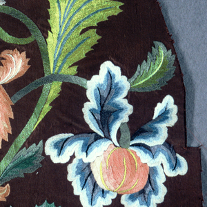 Fragment of dark brown silk grosgrain with large-scale floral group embroidered in green, blue, orange, yellow, grey and black.