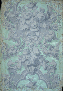 On pale green ground, thick gray scroll-work enframement of flowers; festoons. Shaded with horizontal green lines.
