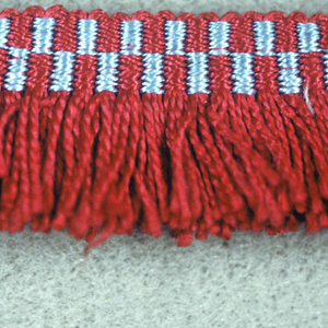 Fringe with a red and blue checkerboard heading. Skirt threads are red.