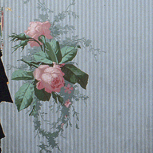 Narrow gray stripes with isolated sprigs of yellow and pink roses. Small-scale foliage in gray-green.