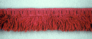 Red fringe with an ornamental heading and red skirt threads.