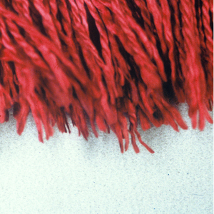 Red fringe with a woven heading and picots on the top edge and red skirt threads.