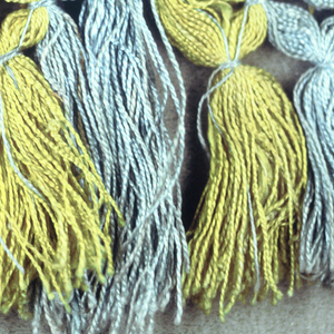 Blue and yellow fringe with a checkerboard heading. Trellis band and skirt threads arranged to form stripes.