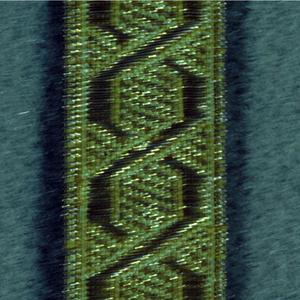Angular guilloche design in yellow and metallic thread.