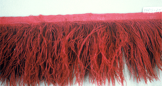Red fringe with a plain-woven heading and a skirt of red silk threads.