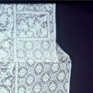 Chasuble embroidered with a cross and I H S twice on the front  I H S twice on the back.