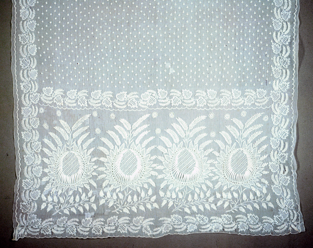 White work veil embroidered all over with tiny dots in white cotton.