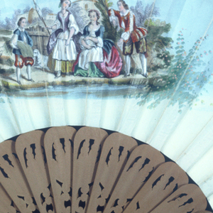 Gilded paper fan leaf decorated with chromolithograph scenes of a musical gathering centered on a man with a hurdy-gurdy. Rococo-style gilding frames the scene; verso: a pastoral vignette with gilded strapwork border. Wood handle is carved and pierced with foliate scrolls.