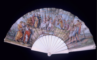 Folding fan with plain celluloid sticks in imitation of ivory. Guards carved with rococo designs. Parchment leaf painted in gouache with a large group of classical figures including Apollo and the Muses. After The Parnassus, the Stanze by Raphael, in the Palace of the Vatican.